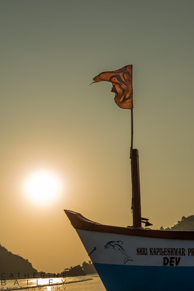 Sun and boat at Palolem Beach | Catherine Bailey Photography