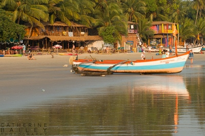 Boats and businesses on Palolem Beach | Catherine Bailey Photography