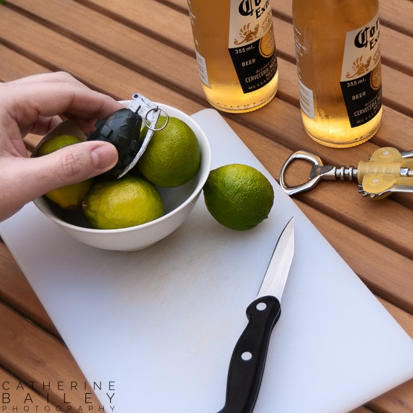 Fake hand grenade in bowl of limes | Catherine Bailey Photography